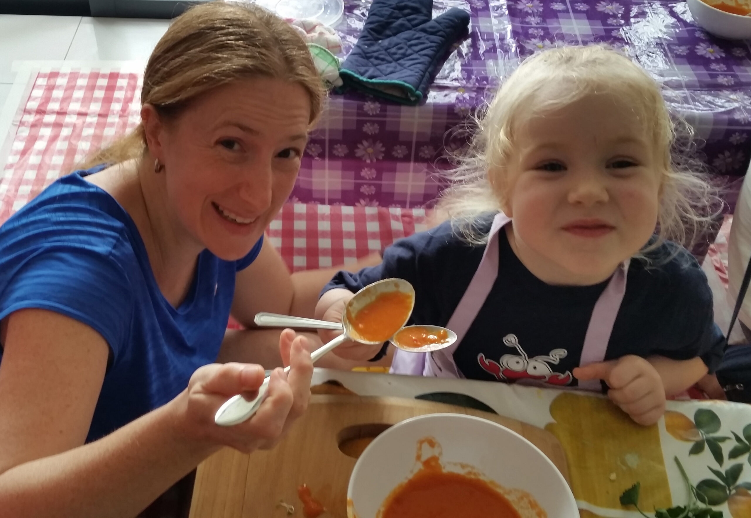 mother and child eating veggie soup